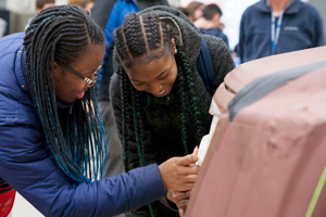 Auto STEAM students work on full-size clay model
