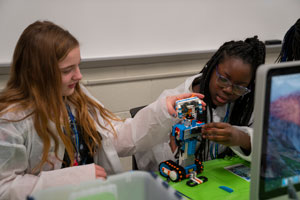 girl scouts working on robotics engineering together